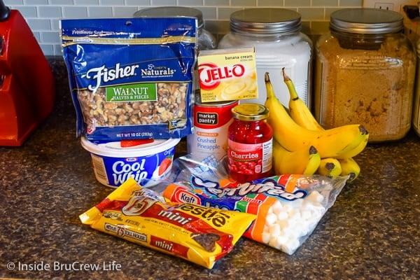 Banana Split Fluff Salad ingredients on a dark counter