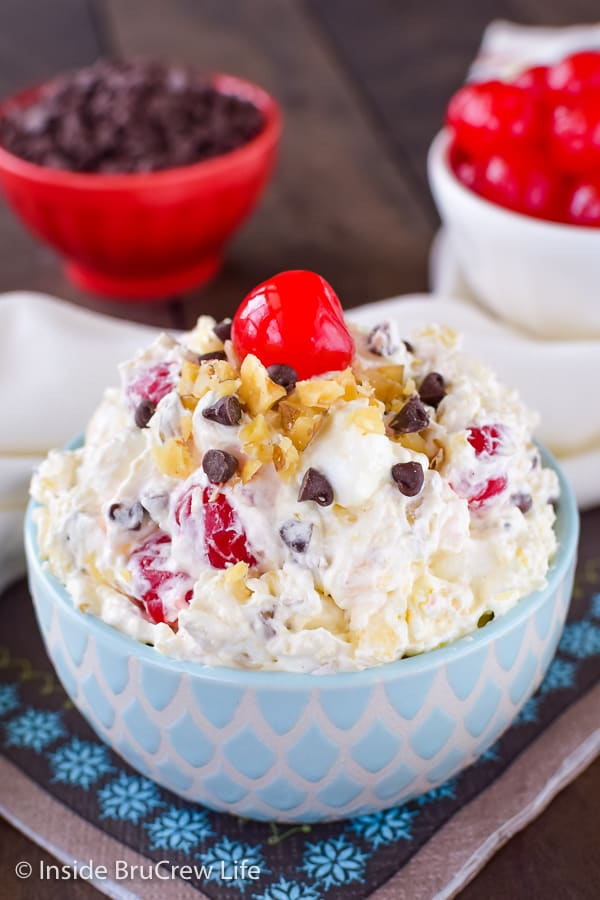 Banana Split Fluff Salad - cherries, bananas, chocolate, and marshmallows make this ambrosia salad the best fluff salad you will every have! Try this recipe for parties and picnics! #bananasplit #dessertsalad #fluffsalad #banana #nobake #picnic #summer #ambrosia