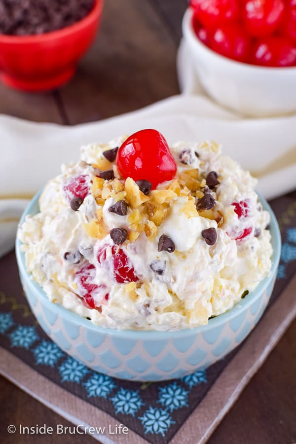 Banana Split Fluff Salad - this creamy ambrosia salad is loaded with cherries, banana, nuts, and marshmallows. Easy no bake dessert for summer picnics or parties. #bananasplit #dessertsalad #fluffsalad #banana #nobake #picnic #summer #ambrosia