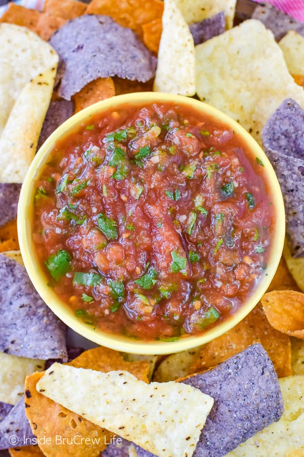 Easy Homemade Salsa - onions, canned tomatoes, and cilantro come together in minutes for this simple salsa. Great dip recipe! #salsa #homemade #chipsanddip #tomatoes #recipe
