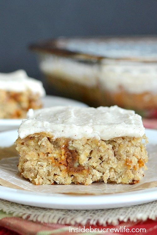 Shredded apples, cinnamon chips, and cinnamon frosting make these easy oatmeal bars a must make.