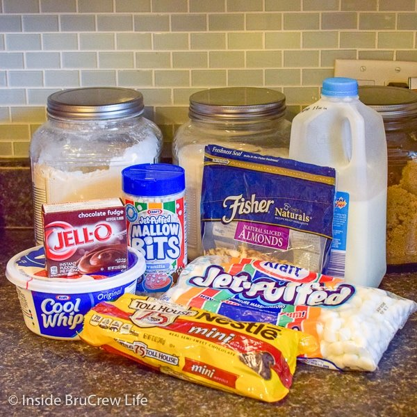 All the ingredients to make Rocky Road Fluff Salad on a dark counter