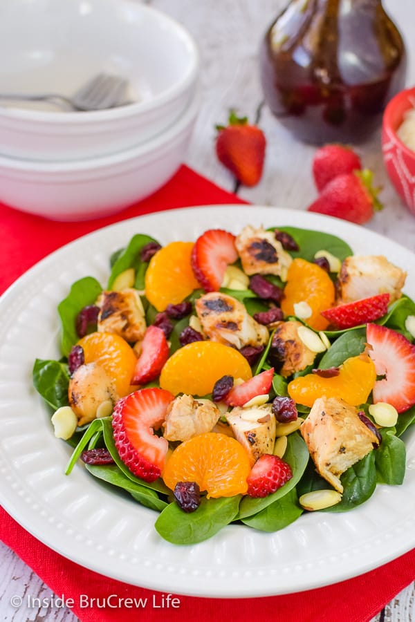 Strawberry Orange Spinach Salad - add your favorite fruits, nuts, and cheese to this easy spinach salad! Great recipe to make for the hot summer months! #salad #strawberry #spinach #healthy #grilledchicken