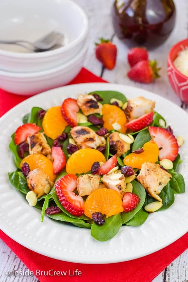 Strawberry Orange Spinach Salad - fruit, nuts, cheese, and a homemade salad dressing make this strawberry spinach salad taste so good. Make this easy recipe for summer dinners! #salad #strawberry #spinach #healthy #grilledchicken