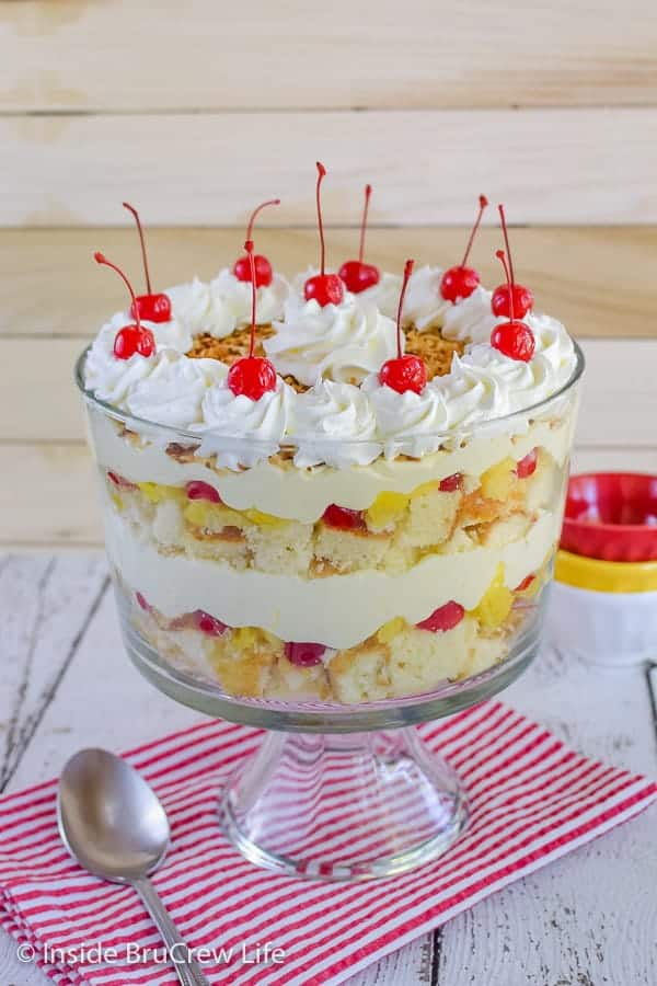 Pina Colada Cake Trifle - this easy cake trifle has layers of pineapple cake, no bake coconut cheesecake, and fruit. Easy recipe to make for summer parties and picnics! #pinacolada #coconut #trifle #nobakecheesecake #cakemix #caketrifle