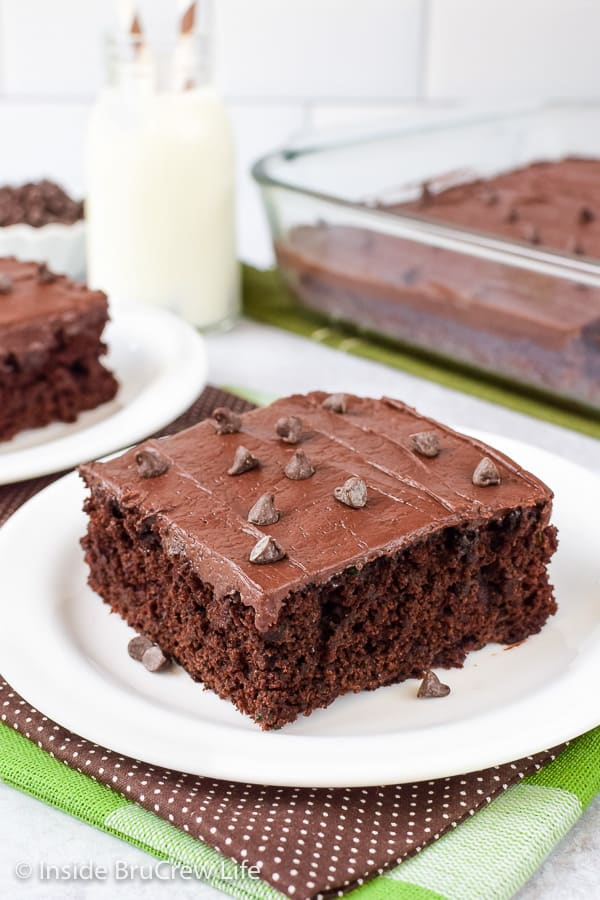 Frosted Zucchini Brownies - shredded zucchini and dark chocolate give these cake like brownies a delicious and rich flavor and texture. Make this easy recipe with the extra zucchini from your garden. #brownies #darkchocolate #zucchini #chocolatefrosting