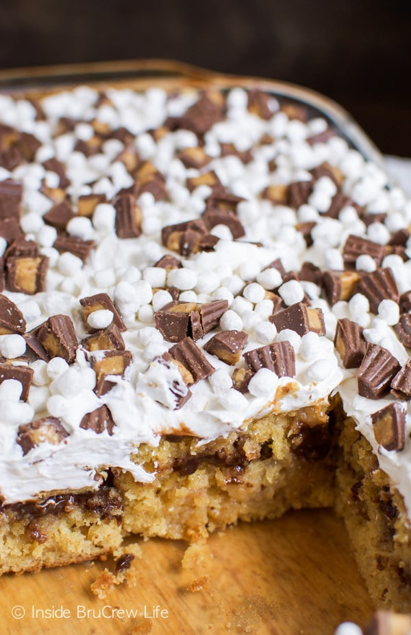 Peanut butter, fudge, and marshmallow make this poke cake a must make dessert.