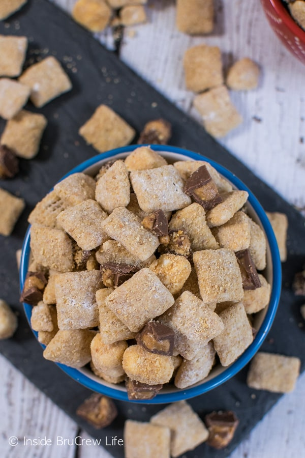 Adding Reese's and smore's make this muddy buddies such a fun snack mix to munch on!