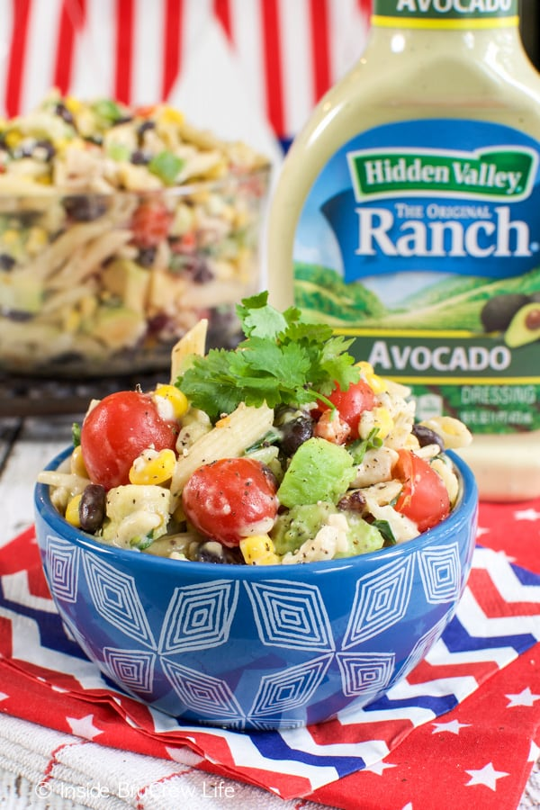Veggies, chicken, and dressing makes this summer pasta salad one you will make over and over.