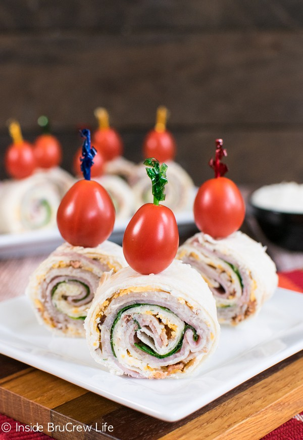 These easy pinwheels are layered with meat and cheese and an easy cheese dip.  Great for packing in lunches or eating as an after school snack!