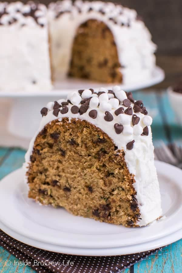 Graham crackers, chocolate chips, and marshmallow frosting makes this zucchini bundt cake the best thing you can do with your extra veggies.