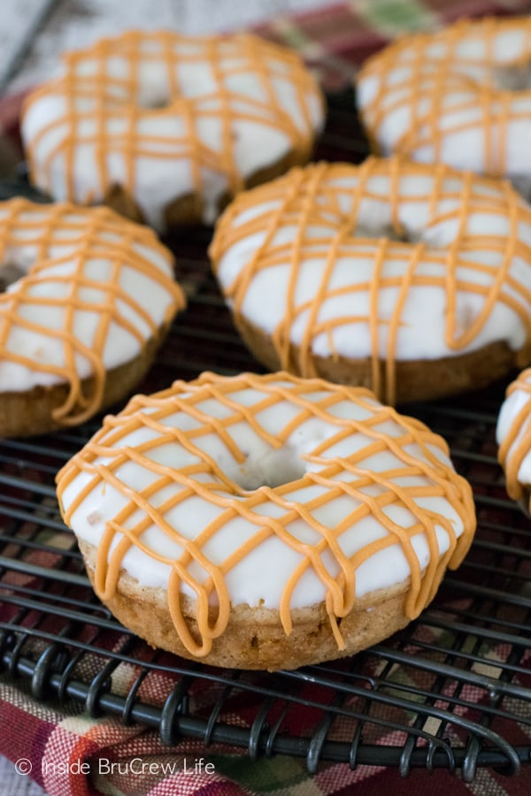Cake mix donuts get a fun fall flair when apples and butterscotch is added into the mix. Great for fall breakfast!