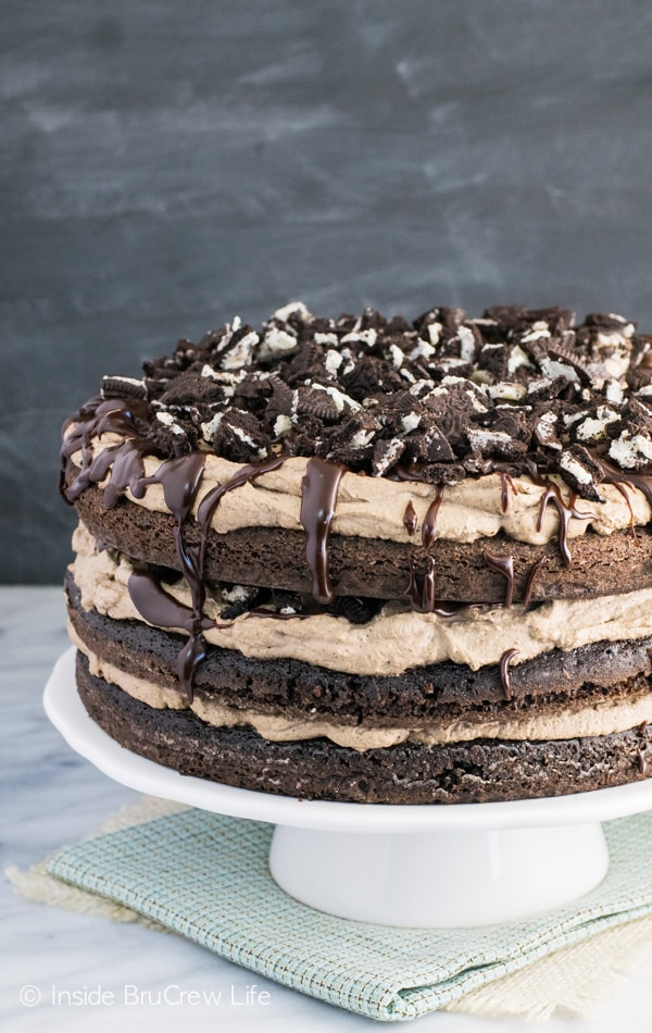 Coffee cream, chocolate drizzles, and crushed cookies make this chocolate cake so amazing!