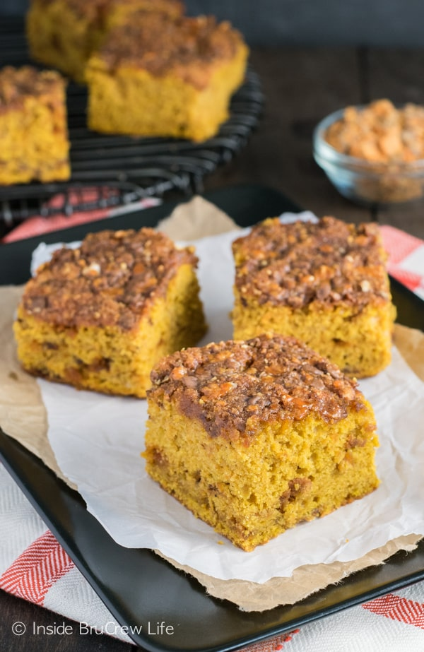 A gooey Butterfinger topping makes this soft pumpkin cake a must make this fall!