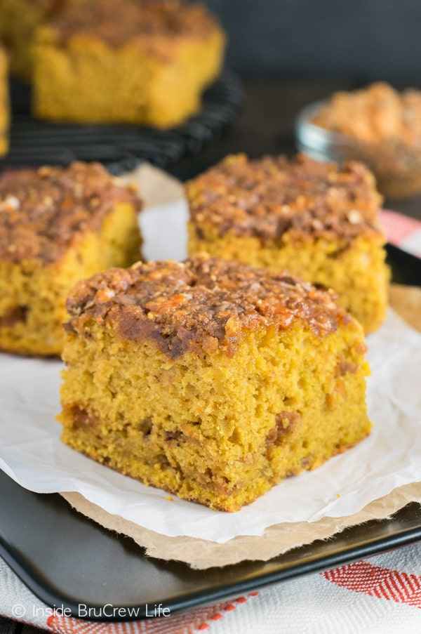 This soft pumpkin cake has a gooey Butterfinger crumble topping. It is amazing!