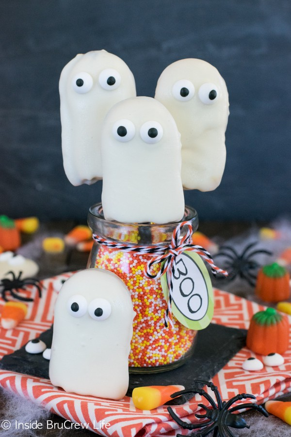 Dipping cookies in white chocolate and adding googly eyes makes the cutest little ghosts! Perfect for Halloween!