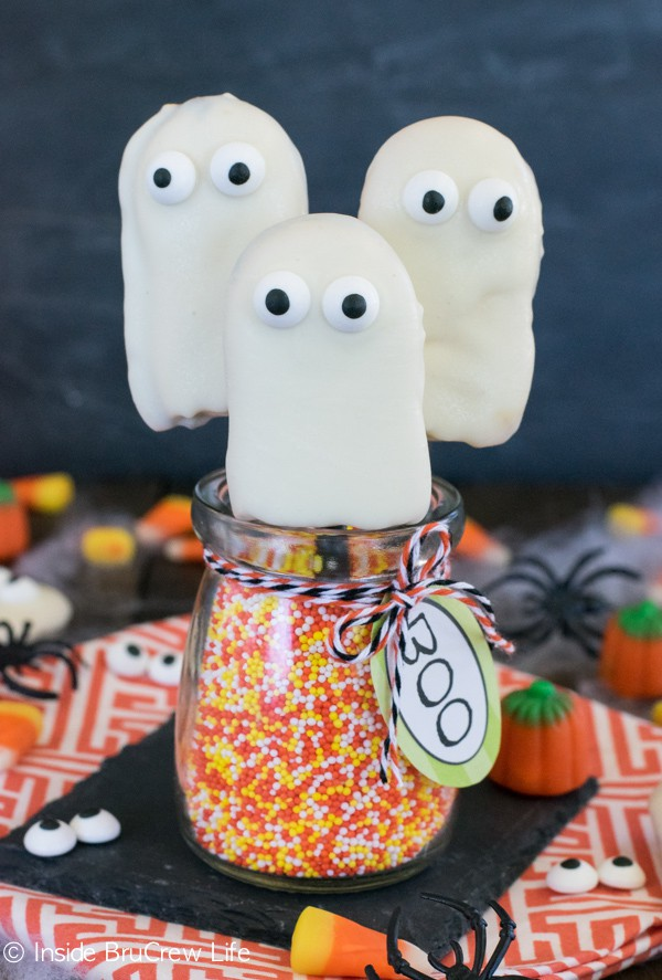These easy ghost cookies are made with 3 ingredients. Perfect Halloween treat for parties!