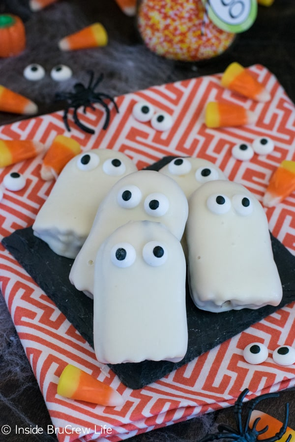 White chocolate and googly eyes turn these store bought cookies into the cutest ghosts!!!