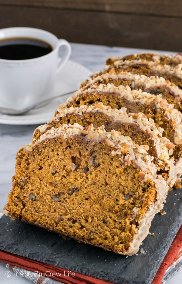 Pumpkin Pecan Bread - this easy pumpkin bread has a sweet praline pecan glaze making it perfect for breakfast or snack. Make this easy recipe this fall.