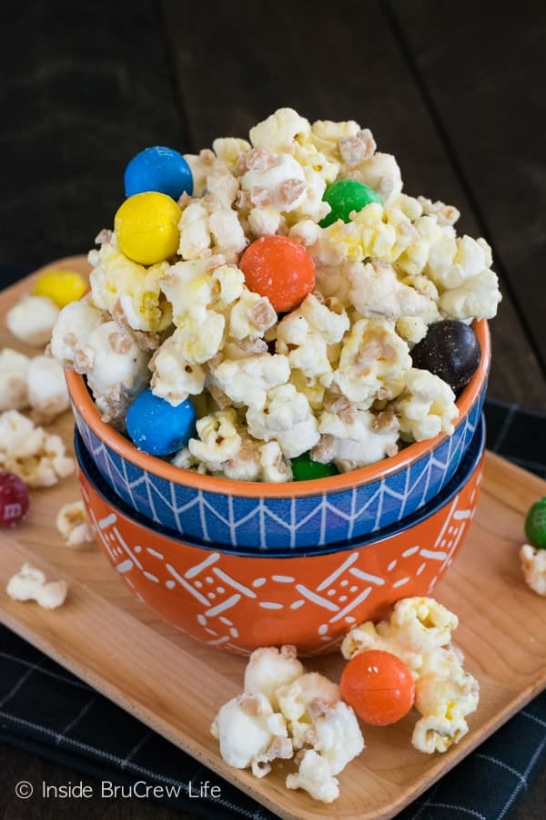 Toffee bits and pretzel M&M's give a fun candy twist to this white chocolate popcorn.