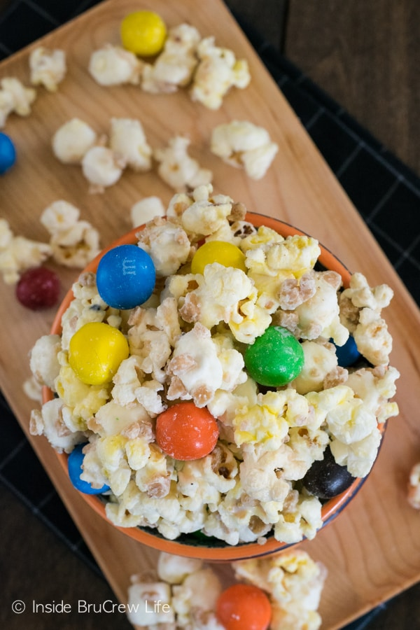 White chocolate covered popcorn loaded with toffee bits and pretzel M&M's is a fun snack for movie night.