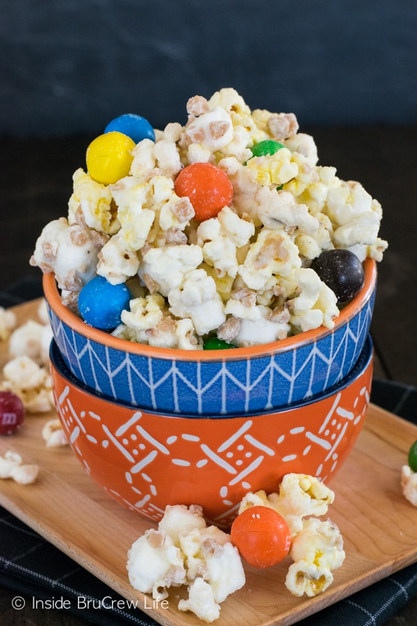 Adding pretzel M&M's and toffee bits to white chocolate popcorn is a very good idea.