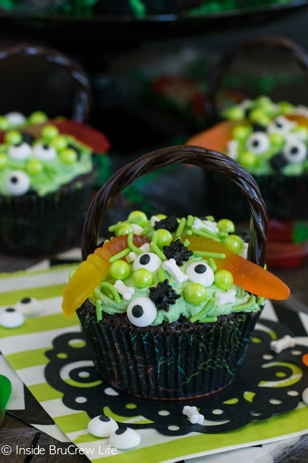 Witch's Cauldron Brownie Cupcakes - chocolate brownies filled with pudding frosting and creepy toppings makes a fun Halloween treat.