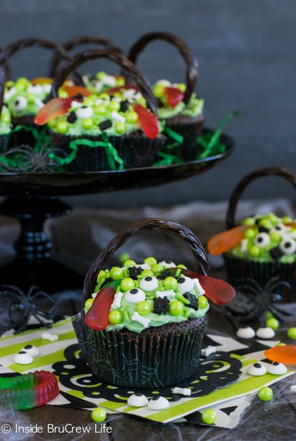 Brownie cupcakes become witch's cauldrons when you add green pudding frosting and spooky sprinkles!