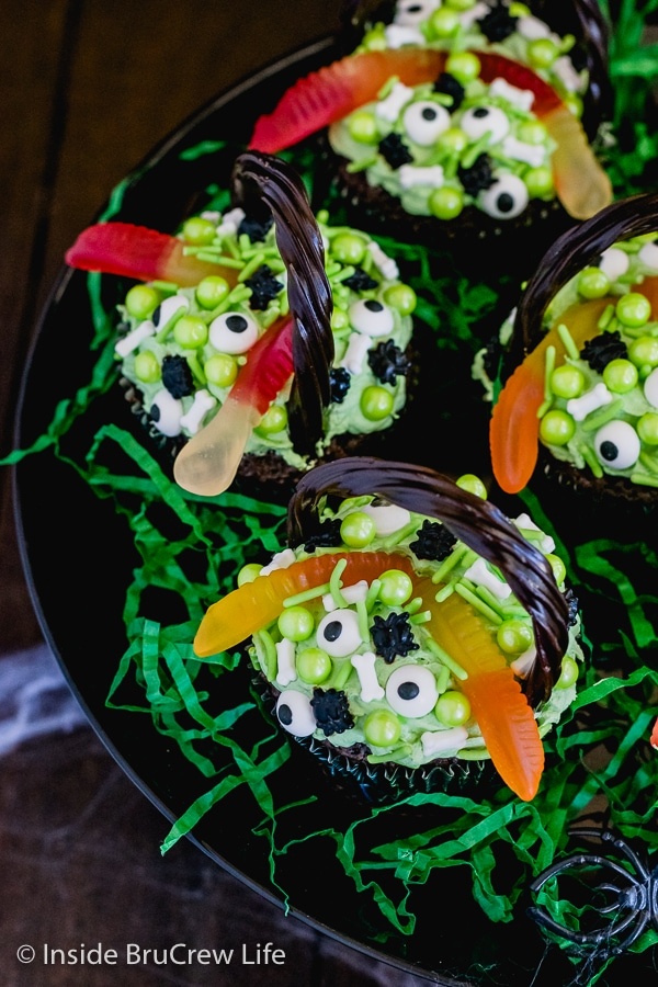 Overhead picture of the top of Witch's Cauldron Brownie Cupcakes on a black cake plate
