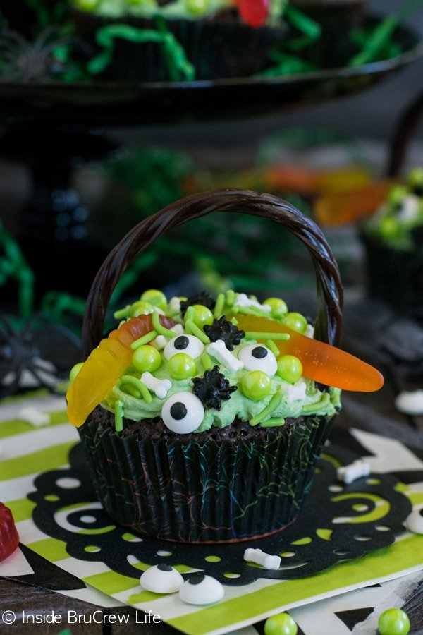 Witch's Cauldron Brownie Cupcakes - green pudding frosting and creepy sprinkles make these a hit at Halloween parties!