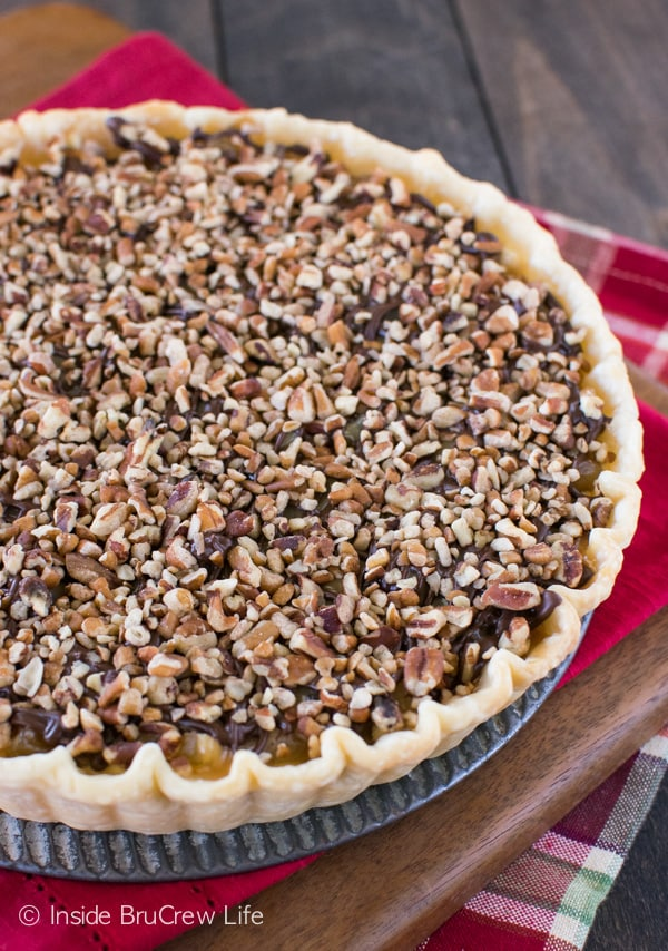 Adding caramel, chocolate, and nuts makes this apple tart a must make dessert!