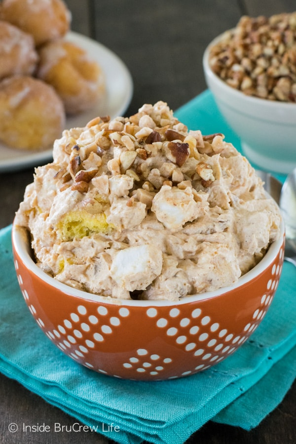 This easy no bake pumpkin pudding salad is the perfect holiday treat. It is full of pumpkin, nuts, and donut holes!!