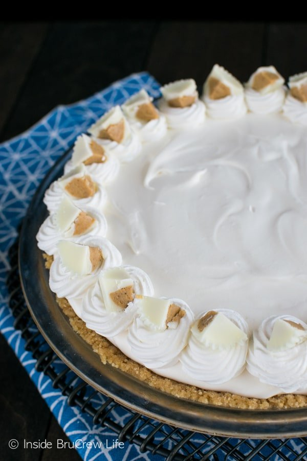 Adding a layer of white chocolate pudding to a no bake peanut butter cheesecake makes this dessert disappear in record time!