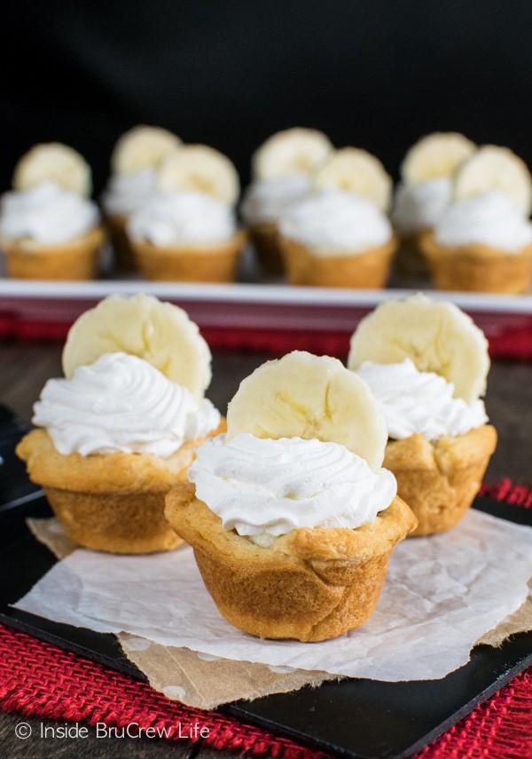 A hidden banana cheesecake and Nutella center makes these Banana Nutella Crescent Cups a fun dessert.
