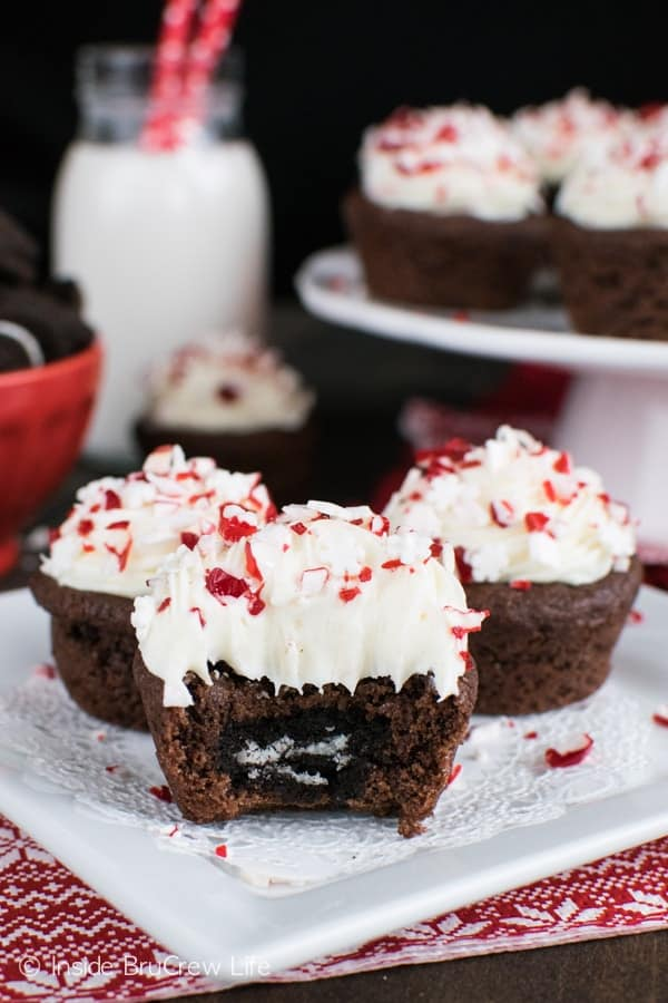 These easy Chocolate Peppermint Oreo Cookie Cups have a hidden cookie center and are topped with peppermint frosting and candy pieces. Great holiday treat!