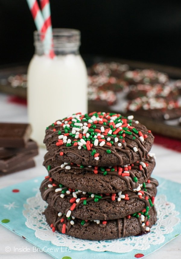 Adding chocolate drizzles and a hidden candy bar makes these Triple Chocolate Cookies the best dessert to have with a glass of milk.