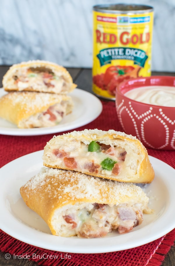 Filling biscuits with cheese and vegetables makes these Chicken Alfredo Calzones great for dinner or game day! Easy recipe.
