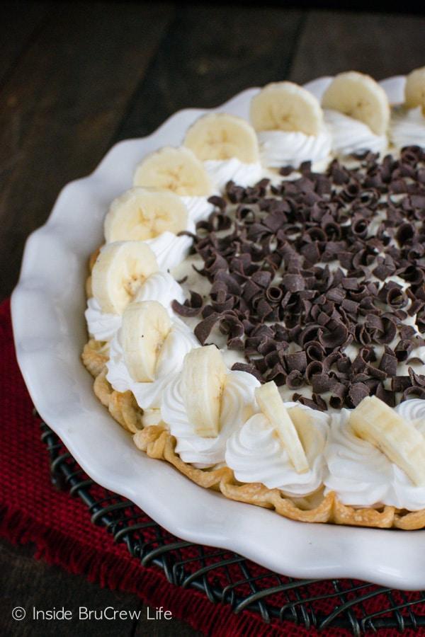 Bananas, pudding, and fudge make this Fudge Bottom Banana Cream Pie a new family favorite dessert recipe.
