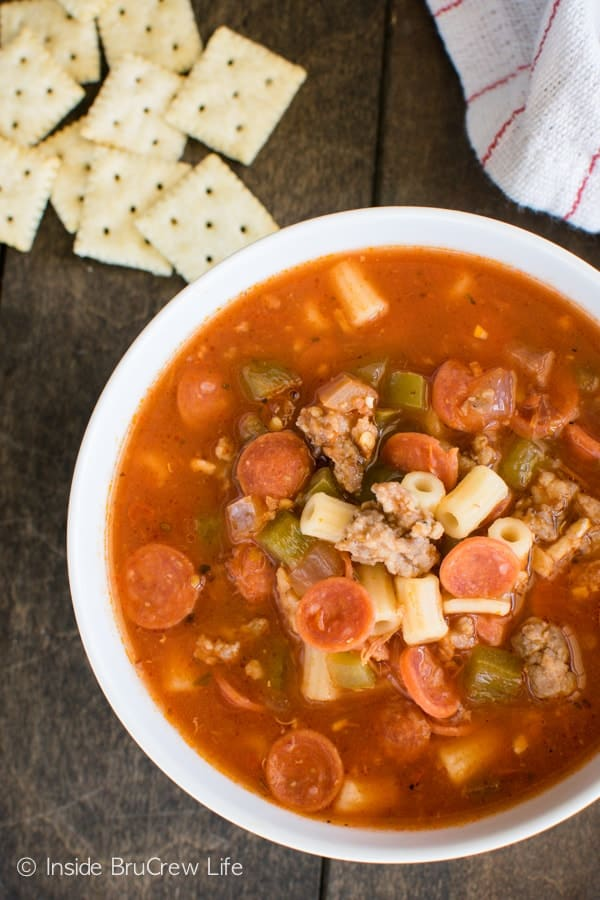 Pizza Minestrone Soup - this easy soup recipe has pizza toppings, noodles, and tomatoes in one pot. Perfect cold weather food!