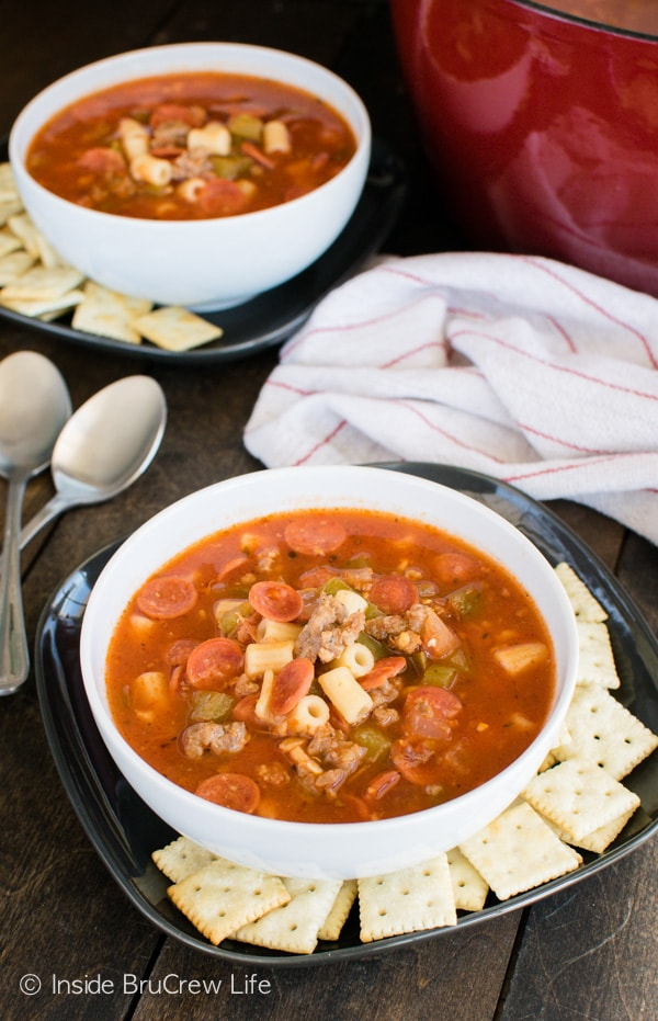 These easy one pot tomato soup recipe has plenty of veggies and pasta. This Pizza Minestrone Soup is comfort food on a cold day.