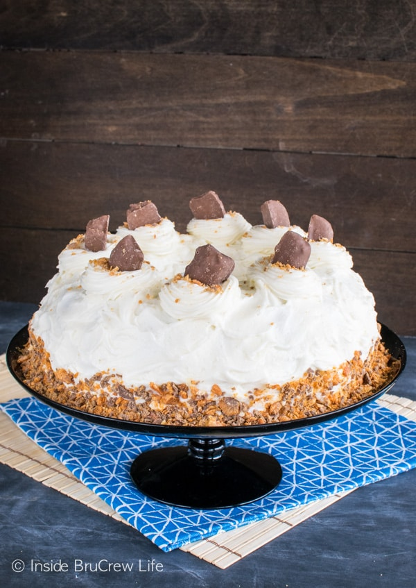 Adding Butterfinger candy bars and cream cheese frosting makes this Banana Butterfinger Bundt Cake an awesome dessert recipe.