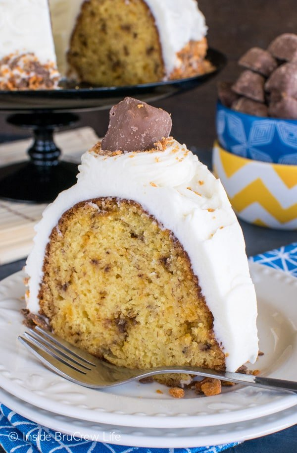 Candy bars and cream cheese frosting make this Banana Butterfinger Bundt Cake disappear in a hurry. Great dessert recipe.