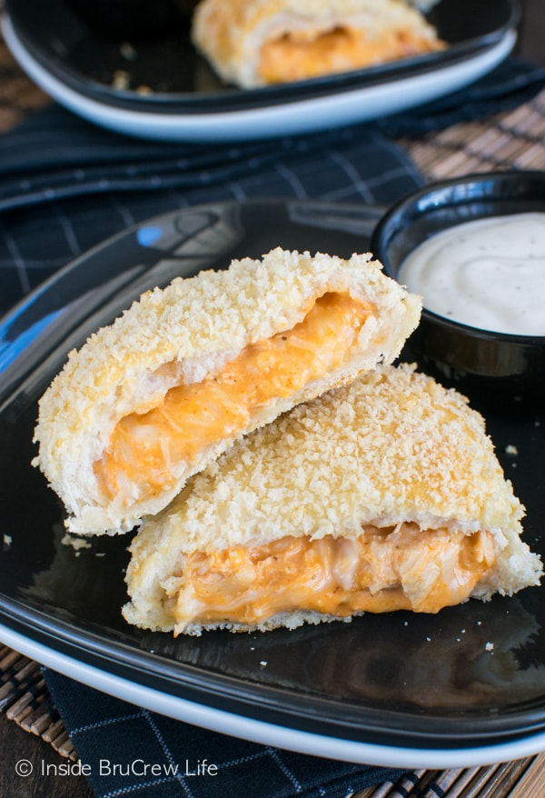 Wrapping biscuits around chicken dip makes these Buffalo Chicken Calzones a hit at dinner or game day parties. Great appetizer recipe.