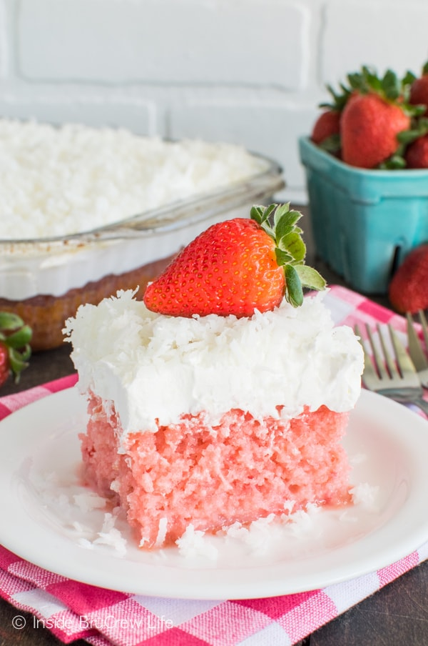 Coconut and strawberry come together in this delicious Strawberry Coconut Poke Cake. It's a great spring dessert recipe.