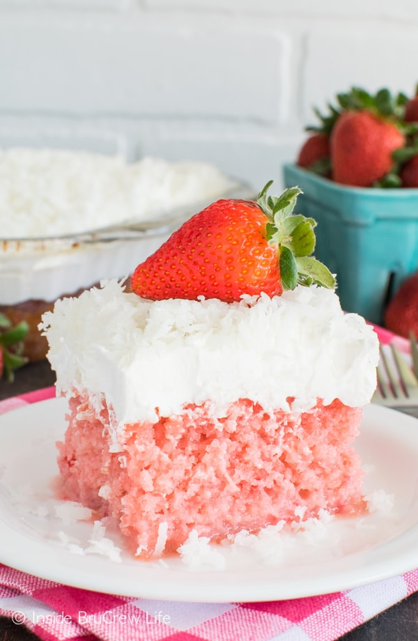 Adding milk and coconut makes this Strawberry Coconut Poke Cake an easy but decadent spring dessert recipe.
