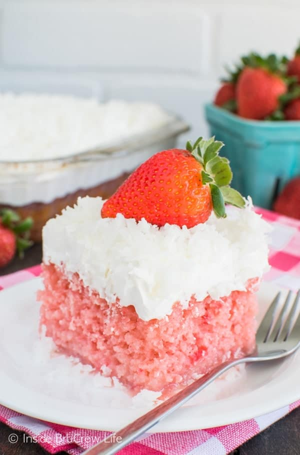 Strawberry Coconut Poke Cake recipe - easy strawberry cake topped with a creamy topping & coconut. Perfect spring or Easter dessert.
