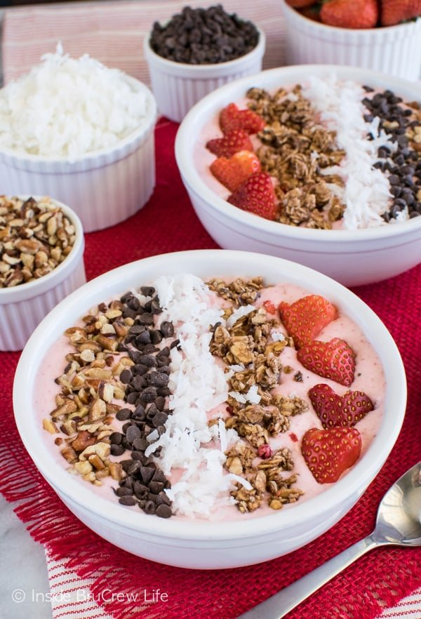 Add nuts, chocolate, coconut, and granola to the top of this Strawberry Coconut Smoothie Bowl for a delicious crunch. Great breakfast or afternoon snack recipe!