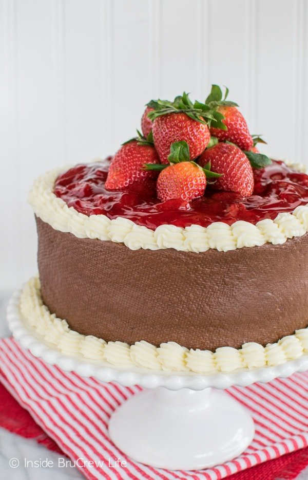 Strawberry Mousse Cake - layers of vanilla, strawberry, and chocolate make this cake disappear. Easy dessert recipe!