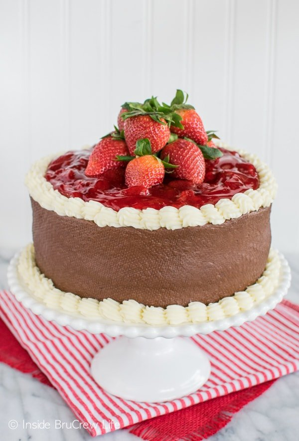 Vanilla cake, strawberries, and chocolate frosting turn this Strawberry Mousse Cake into a work of art. Perfect dessert recipe for Valentine's Day.