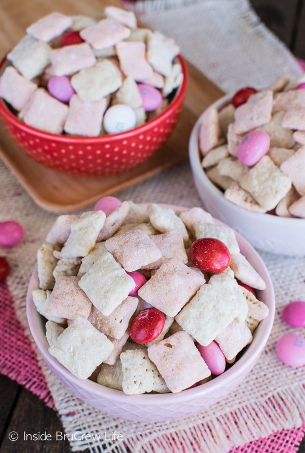 Strawberry cake, M&M's, and shortbread cookies add a fun twist to these easy Strawberry Shortcake Muddy Buddies. Great dessert recipe!